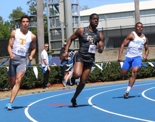 Florida State (center) senior Andre Ewers makes his way in the 200 at the Florida Relays. He is the defending ACC champion in the 100 and this event.