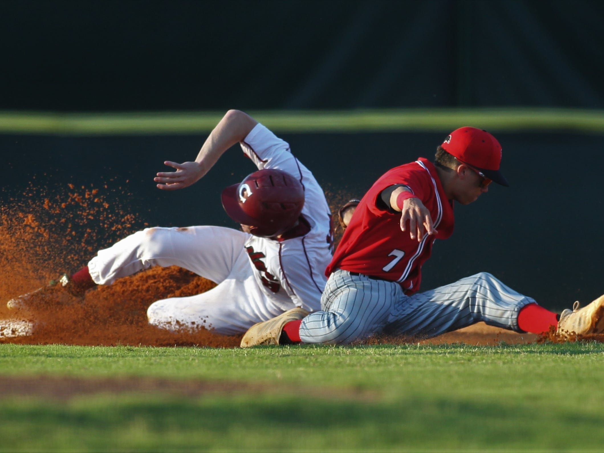 Chiles' Dillon Giesecke slides in with a stolen base, beating the tag from Leon second baseman True Fontenot as Chiles beat Leon 10-6 during a District 2-8A semifinal on May 7, 2019.