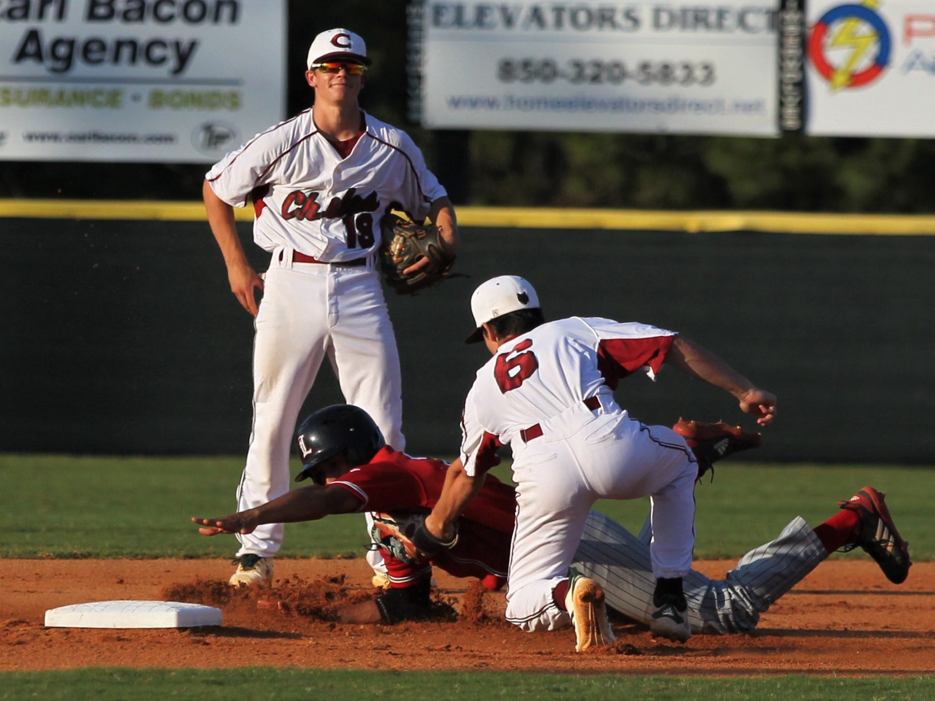 Leon senior Victor Castillo is tagged out while stealing by Chiles freshman Grant Gallagher as Chiles beat Leon 10-6 during a District 2-8A semifinal on May 7, 2019.