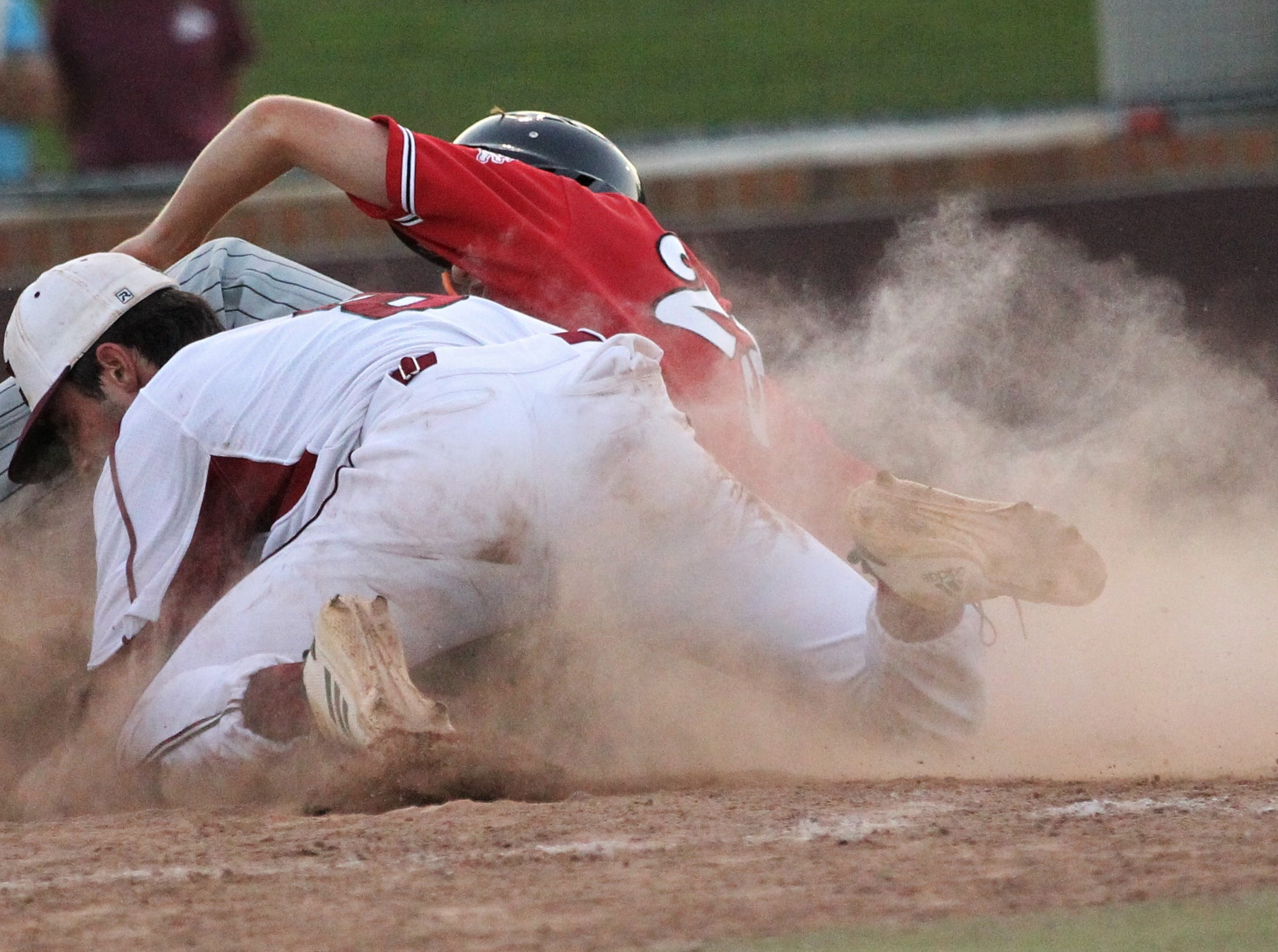 Leon junior Matt Williams slides for home after a passed ball but gets tagged out as Chiles beat Leon 10-6 during a District 2-8A semifinal on May 7, 2019.