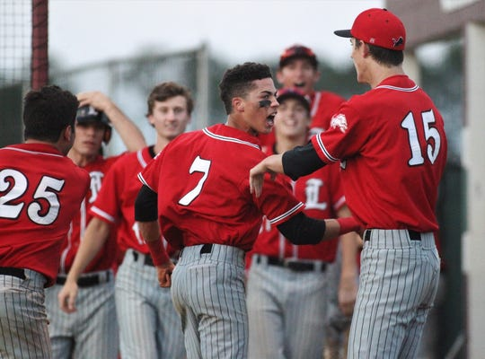 Leon senior True Fontenot celebrates with Will Newell after scoring a run as Chiles beat Leon 10-6 during a District 2-8A semifinal on May 7, 2019.