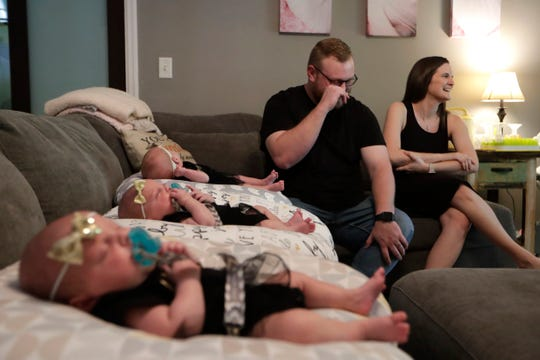 Preparing to celebrate her first Mother's Day as a new mom to triplets, Megan Walker, right, sits with and her husband Bo Walker as the two reminisce on the pregnancy Tuesday, May 8, 2019.