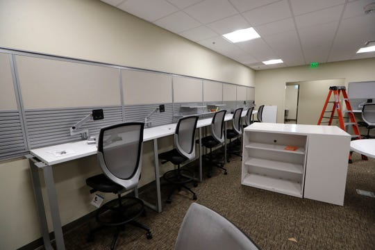 """The """"island"""" in the new FSU PrimaryHealth center on the southwest side of Tallahassee Wednesday, May 8, 2019. The area is used similar to a nurses station but will also be a workspace for doctors, medical assistants and students."""