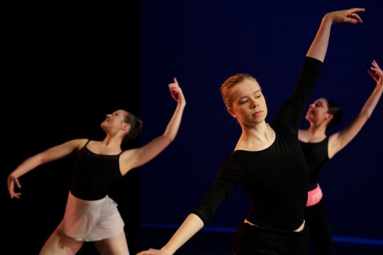 """Tallahassee Ballet dancers Jillian Grall, left, Catalina Good, right and Abby Centers practice during a rehearsal for the 2018-2019 season finale show """"Bernstein & Gershwin!"""" at Ruby Diamond Tuesday, May 7, 2019."""