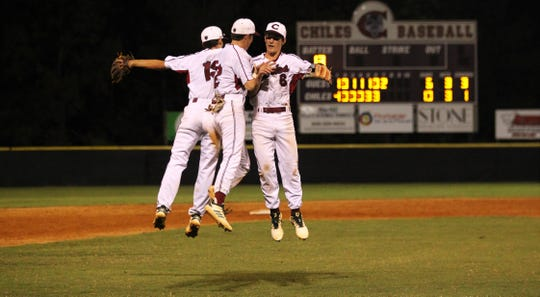 Chiles freshmen Parker McDonald (19), Jaxson West (12) and Grant Gallagher (6) celebrate as Chiles beat Leon 10-6 during a District 2-8A semifinal on May 7, 2019.