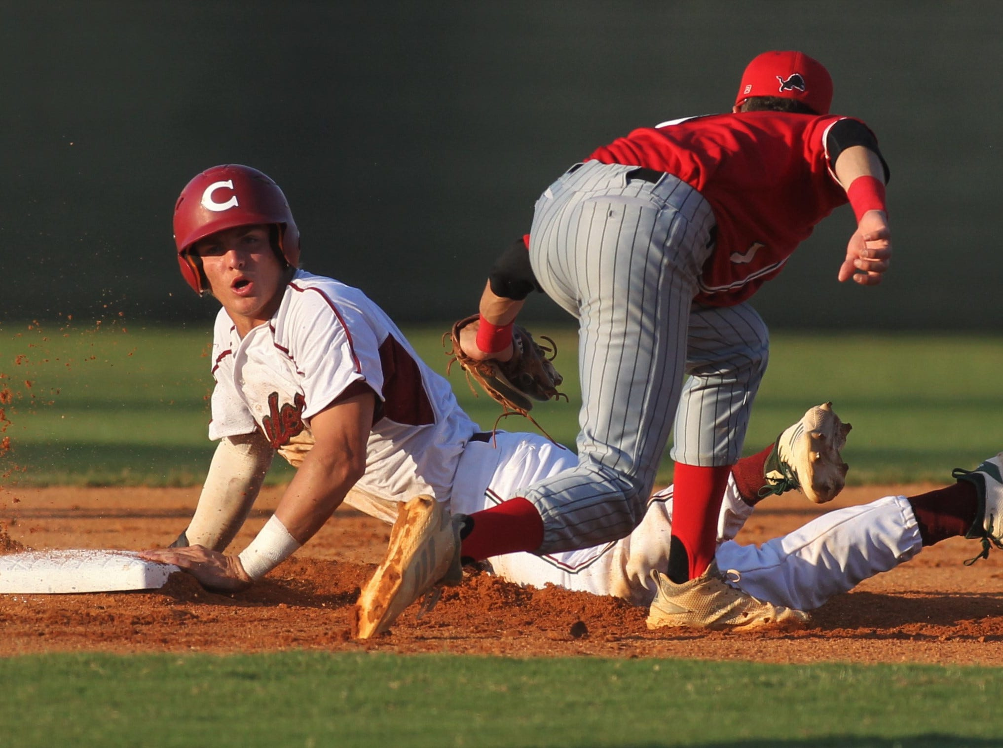 Chiles junior Garrett Greene steals a base as Chiles beat Leon 10-6 during a District 2-8A semifinal on May 7, 2019.