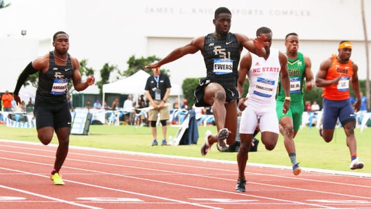 FSU's Andre Ewers dashes across the finish line in the 100 at the Tom Jones Memorial. This meet took place at the University of Florida on April 26, 2019.