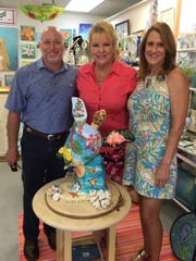 Adam and Traci Preuss were recently named winners of the Bahama Mama Turtle raffle, sponsored by the Mental Health Association in Indian River County. Pictured are Adam Preuss, left, artist Barbara Sharp and Traci Preuss with Bahama Mama.