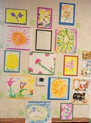 Artwork created by patients of the Florida Cancer Specialists hangs on the wall in the treatment room on Wednesday, May 8, 2019. The artwork was created during the first month of the Arts in Medicine Program, a collaboration between the clinic and the Cultural Council of Indian River County that brings in local artists and performers to interact with patients during treatments to help relieve stress.