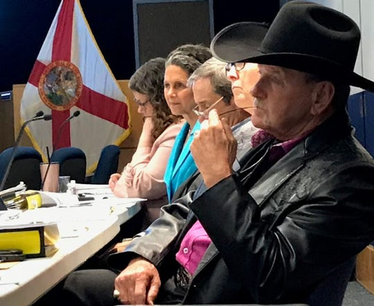 South Florida Water Management District board members including Jacqui Thurlow-Lippisch of Sewall's Point, second from left in blue, and Ron Bergeron of western Broward County, in cowboy hat, listen to a presentation Wednesday, May 8, 2019, during a board workshop on water quality.