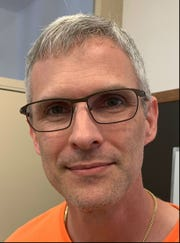 Jason Nunemaker, Fellsmere city manager, poses on May 7, 2019, in his office.