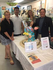 Barbara Sharp, left, David Thomas, Angela Guzenski and Dr. Nicholas Coppola with the Bahama Mama Turtle.
