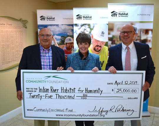 Habitat for Humanity's Scholarship Committee Chairperson Al DeRenzo, left, CEO/Executive Director Sheryl S. Vittitoe and Community Foundation CEO Jeff Pickering with the $25,000 Community Enrichment Fund check.