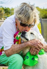 Boots Carter and her dog Winston share a moment at the Vero Beach Dog Park at 3449 Indian River Drive East.