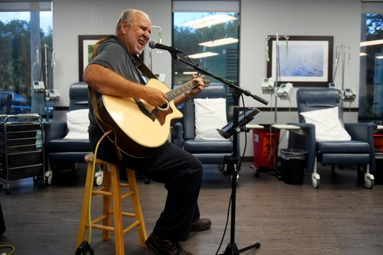 Steve Erickson, a local musician, plays and sings soothing music on Tuesday, May 7, 2019, in the treatment room at Florida Cancer Specialists in Vero Beach as part of an Arts in Medicine Program sponsored by the Cultural Council of Indian River County. The program integrates a variety of art and artists into the clinical setting designed to create a healing environment that can help patients, caregivers and healthcare professionals deal with serious illness.