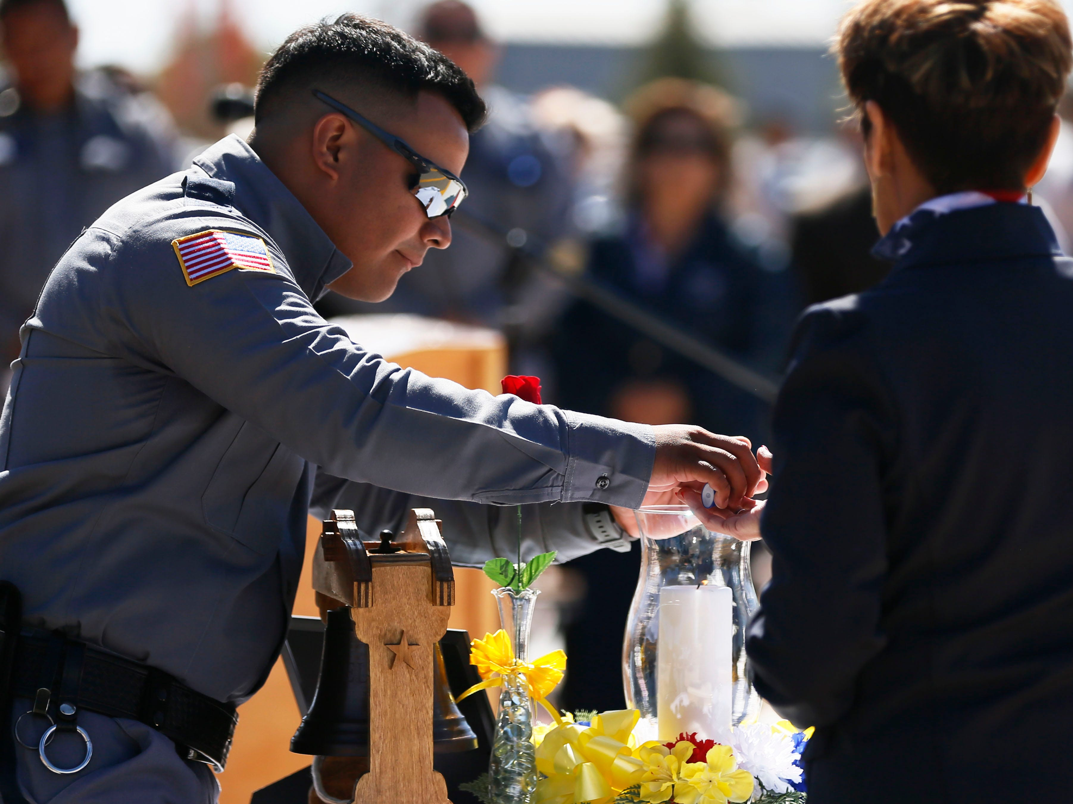 Correctional officer Joseph Horta-Hernandez lights the candle to honor the memory of fallen officers Wednesday, May 8, at Rogelio Sanchez State Jail in El Paso.