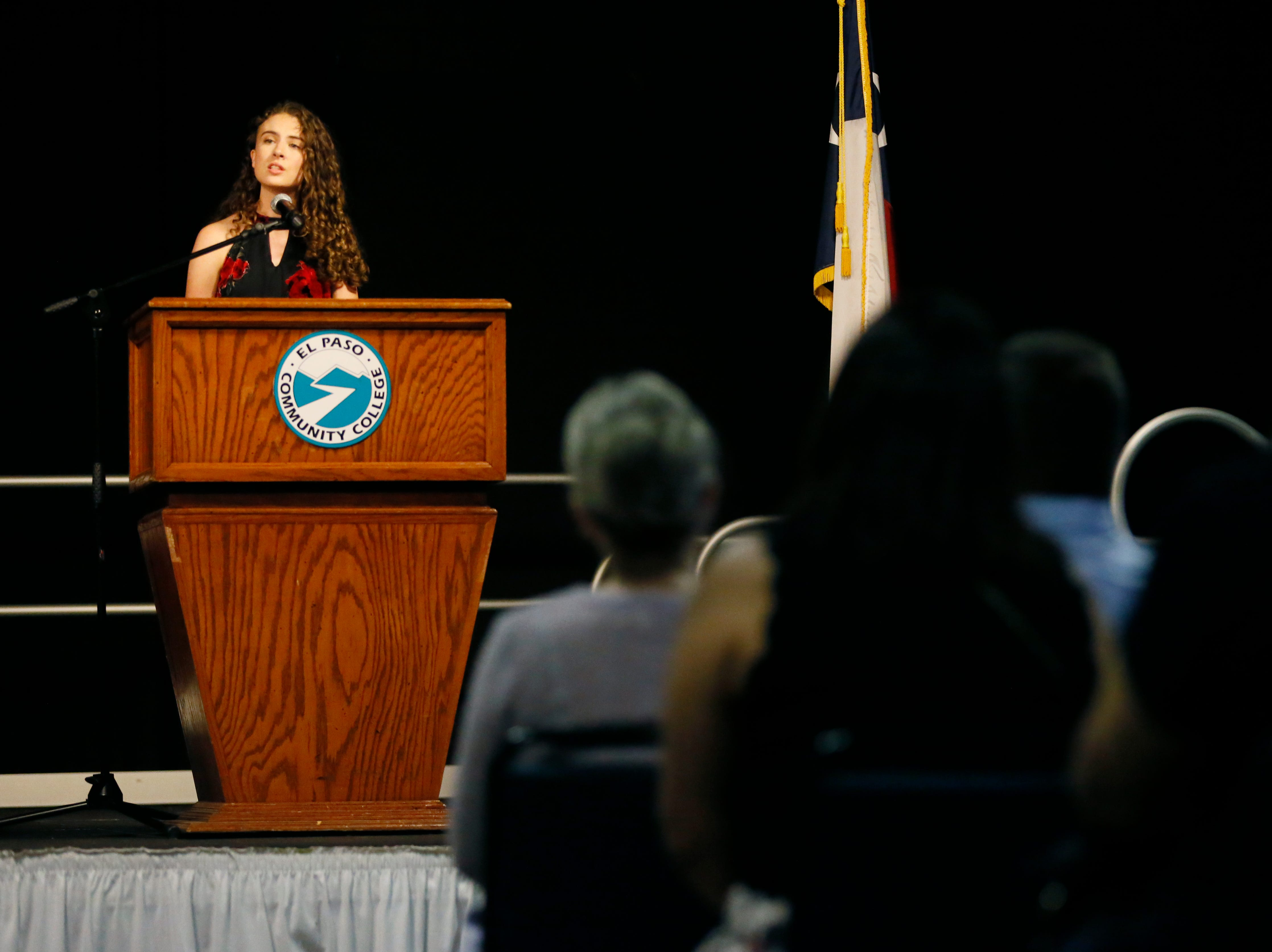 Mission Early College High School student Sidnee Klein gives a speech to her class Tuesday, May 7, at stoling ceremony at EPCC Administrative Service Center in El Paso.