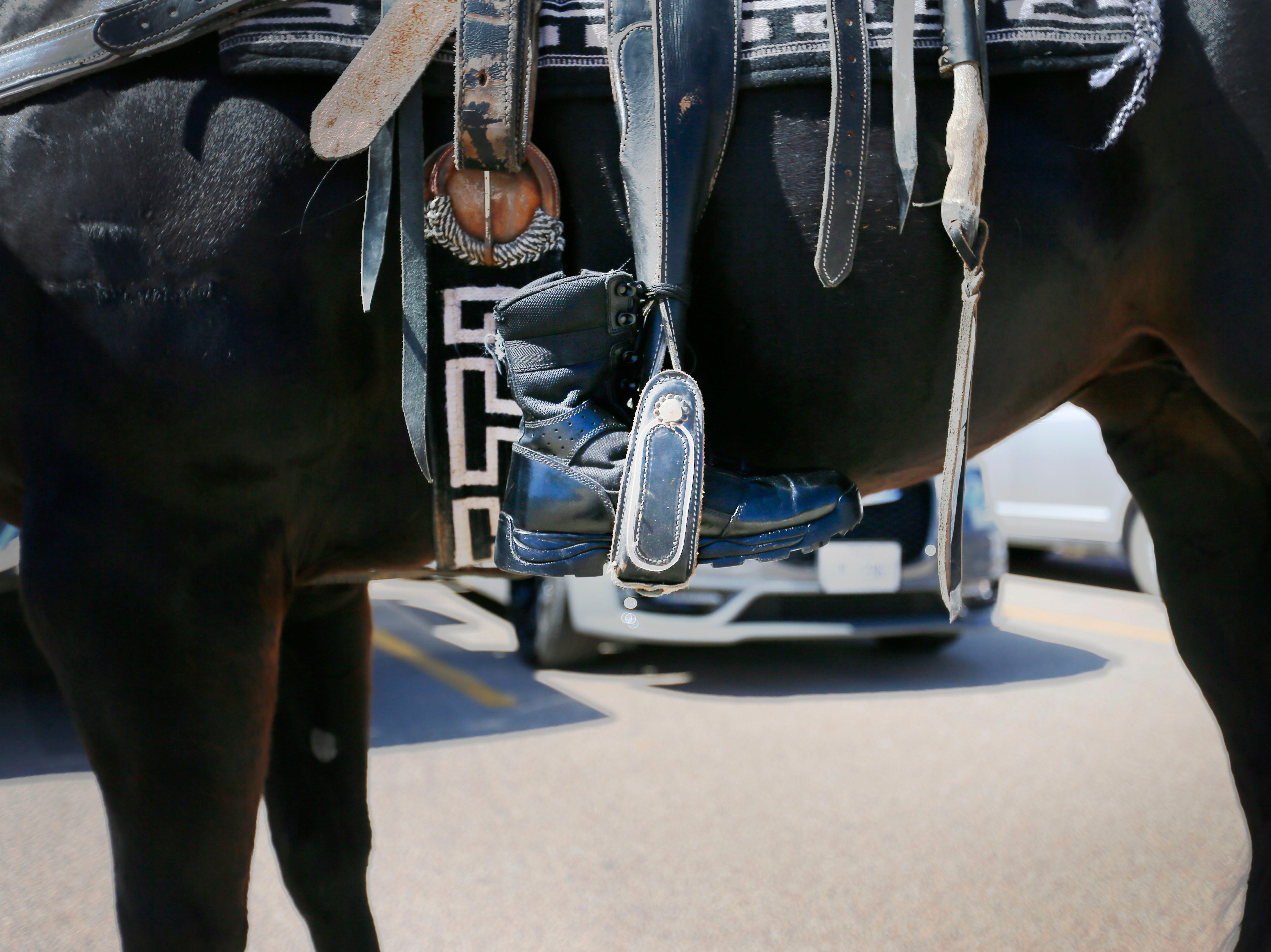 The Riderless horse wears a set of empty boots to honor the memory of fallen correctional officers Wednesday, May 8, at Rogelio Sanchez State Jail in El Paso.