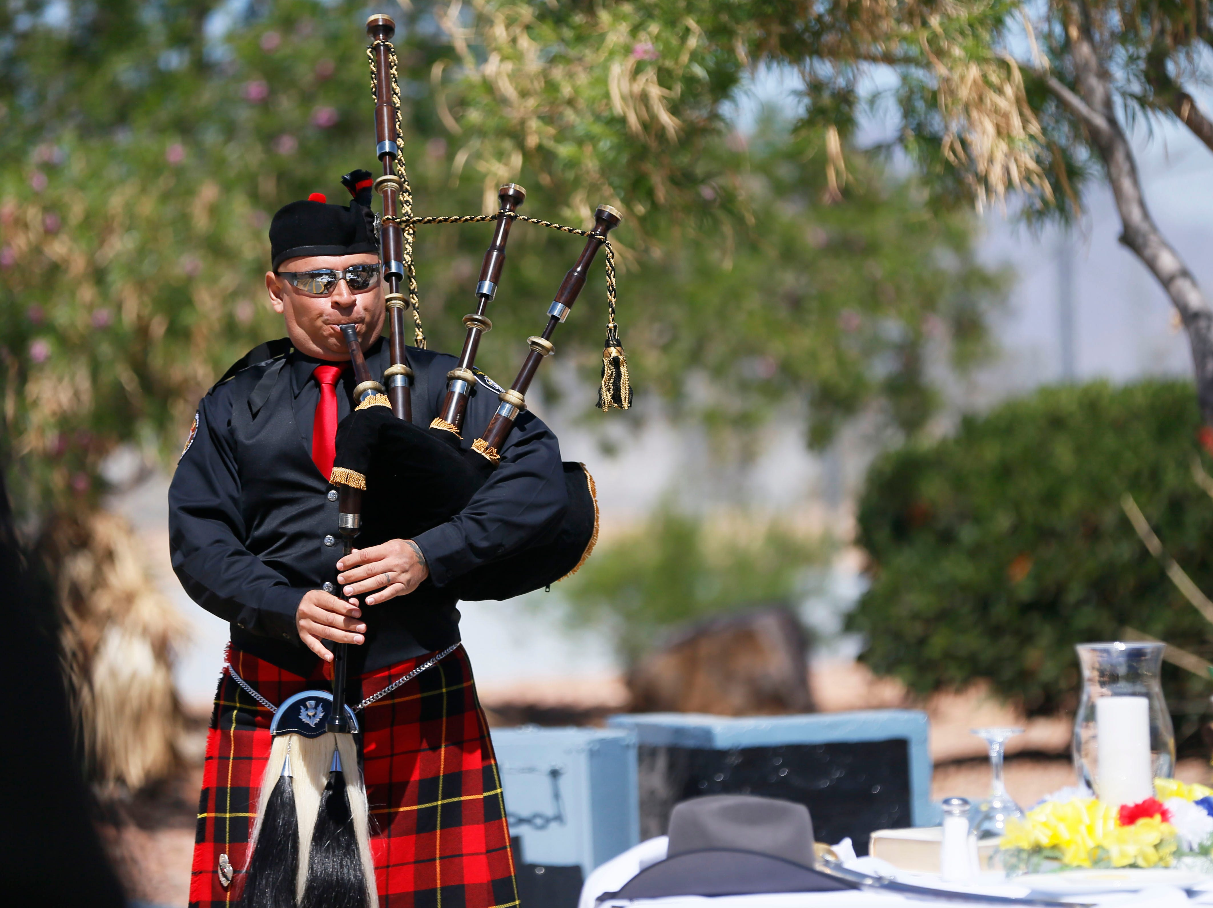 Andy Olivarez, fire department bagpipes, performs during the gathering to honor the memory of fallen correctional officers Wednesday, May 8, at Rogelio Sanchez State Jail in El Paso.
