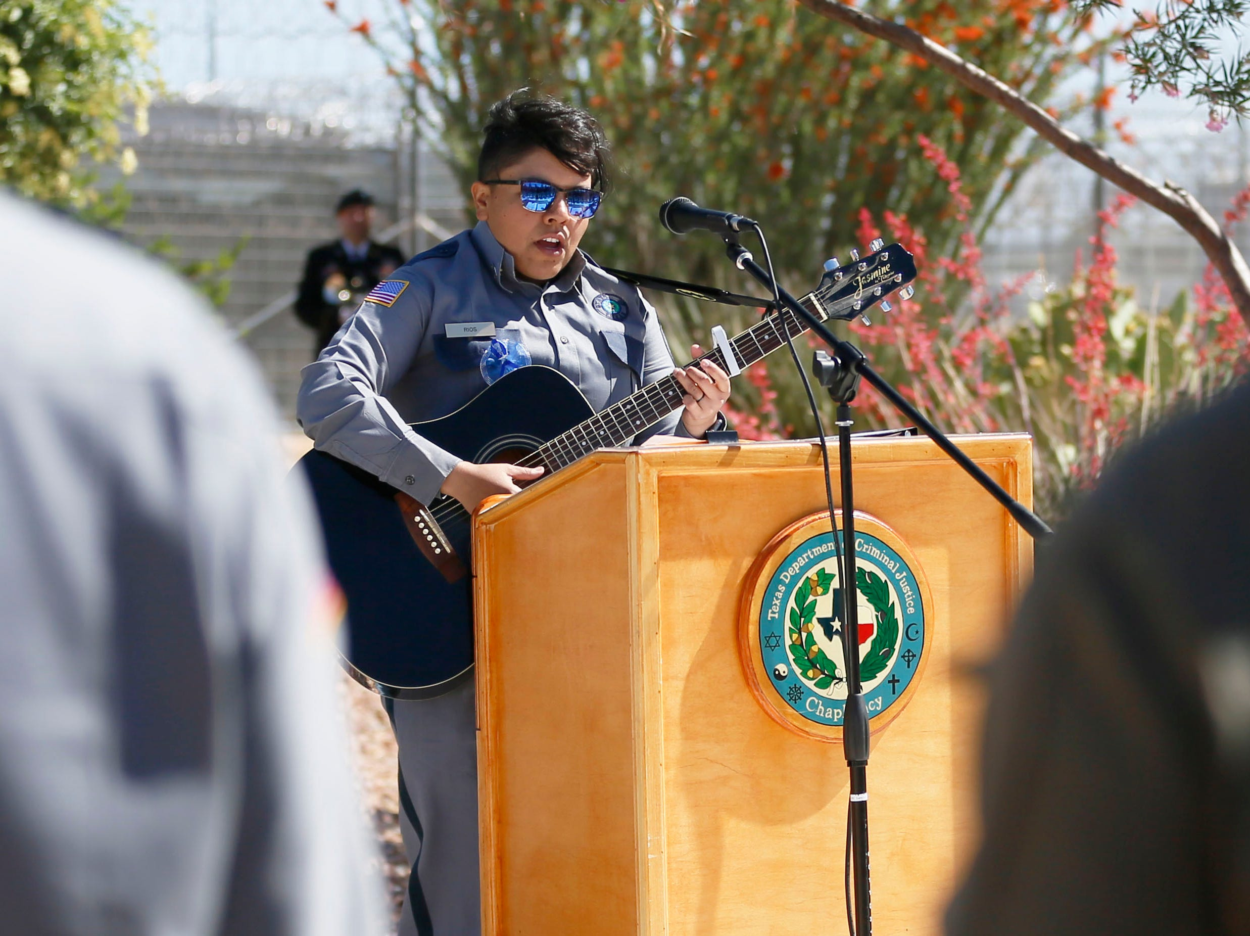 Sergeant of corrections Analucy Rios performs a song to honor the memory of fallen correctional officers Wednesday, May 8, at Rogelio Sanchez State Jail in El Paso.