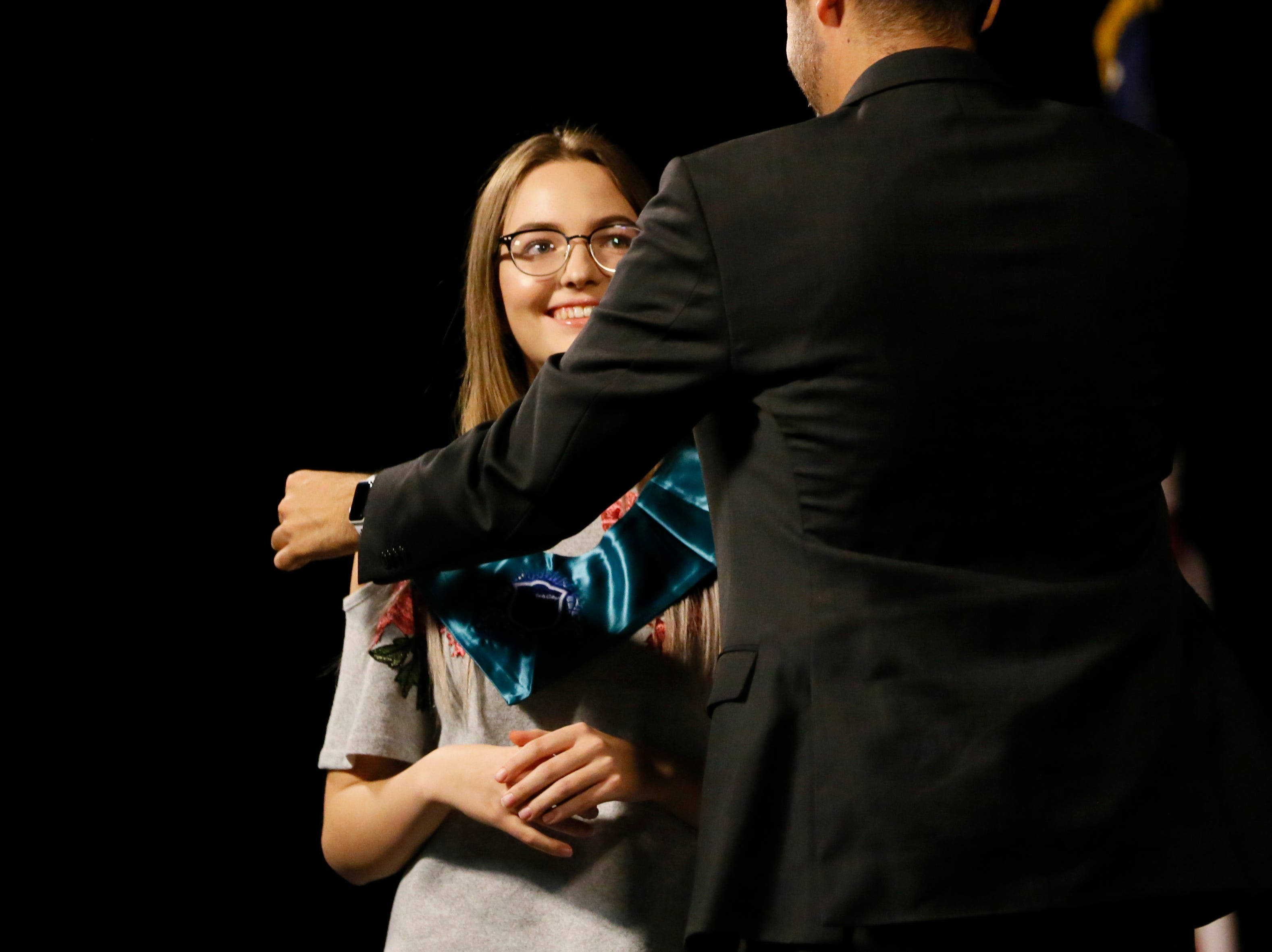 Mission Early College High School Principal Benjamin Ortega presents Jacqueline Turmarin with her stole during their stoling ceremony Tuesday, May 7, at EPCC Administrative Service Center in El Paso.