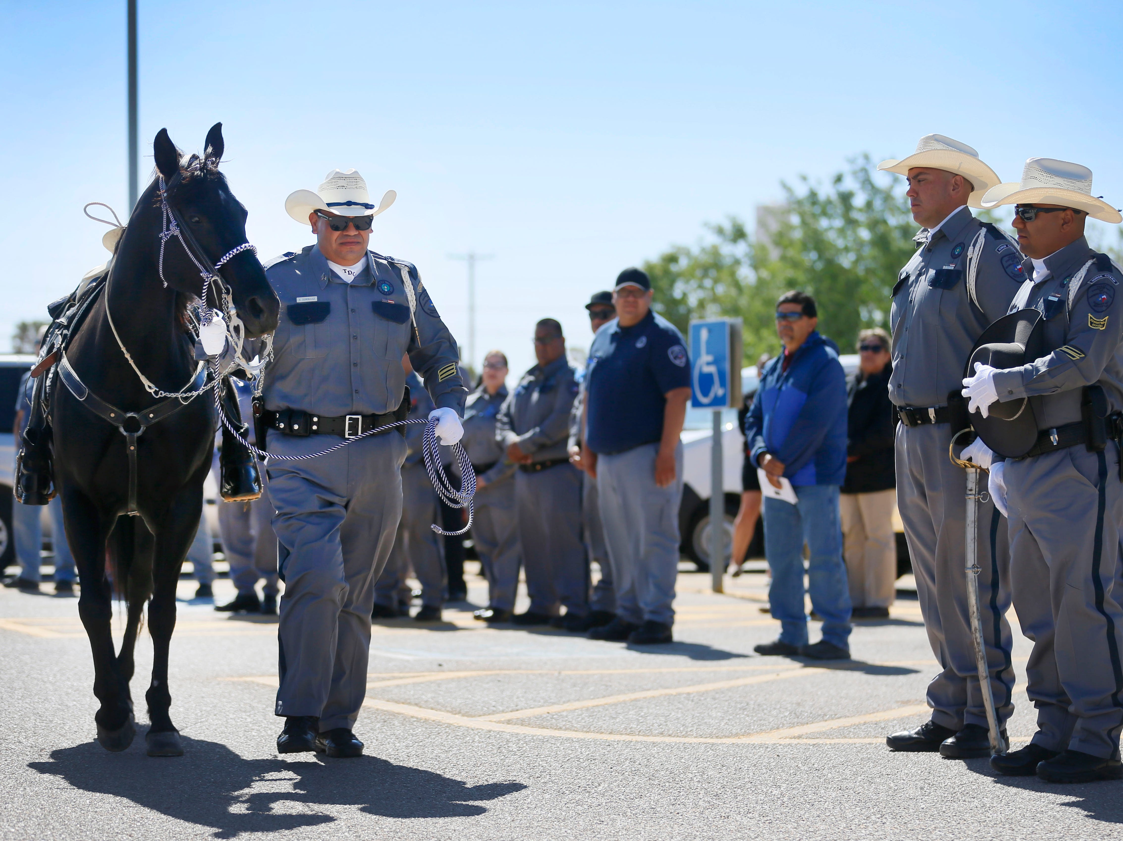 Sergeant Santiago Dominguez leads the riderless horse to honor the memory of fallen correctional officers Wednesday, May 8, at Rogelio Sanchez State Jail in El Paso.