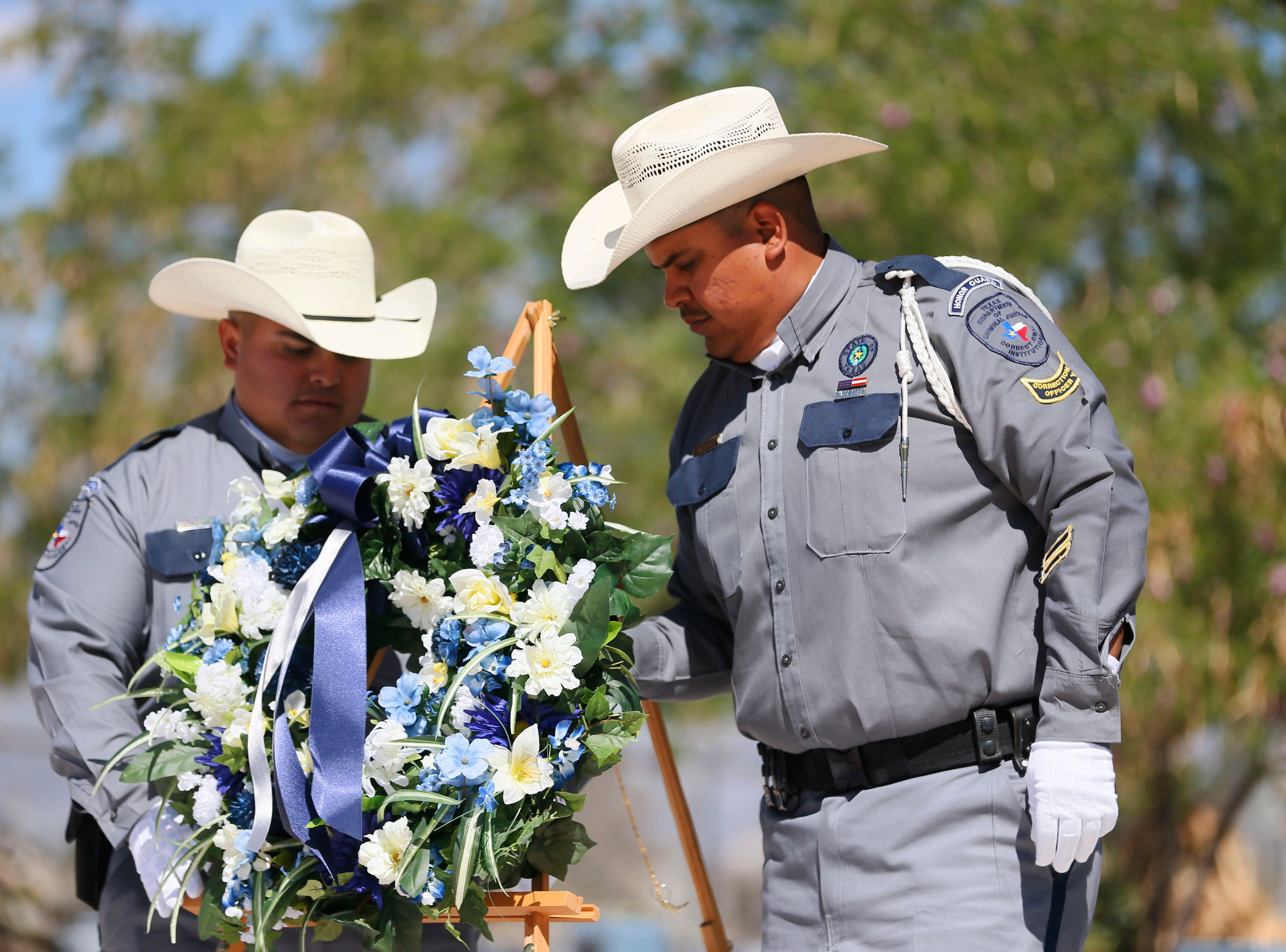 Officer Eric Amesquita, left, and Jesse Cisneros, right, lay the wreath during the gathering to honor the memory of fallen correctional officers Wednesday, May 8, at Rogelio Sanchez State Jail in El Paso.