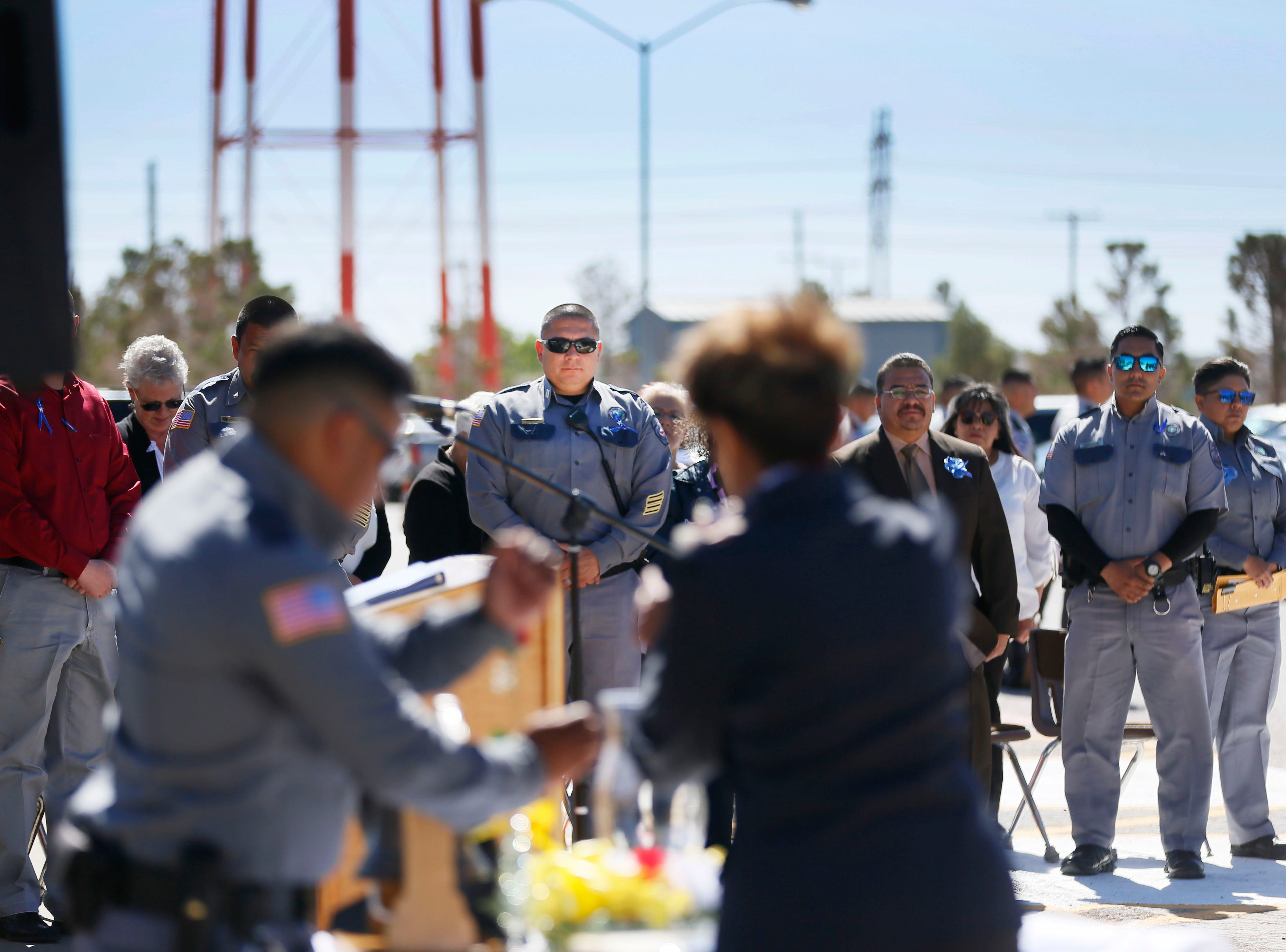Correctional officers watch officer Joseph Horta-Hernandez light the candle to honor the memory of fallen officers Wednesday, May 8, at Rogelio Sanchez State Jail in El Paso.