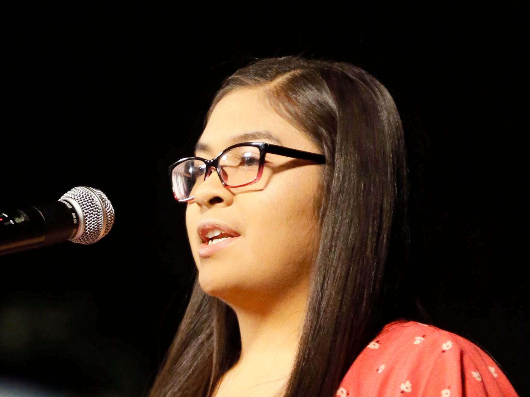 Mission Early College High School student Mia Chan gives a speech to her class Tuesday, May 7, at stoling ceremony at EPCC Administrative Service Center in El Paso.