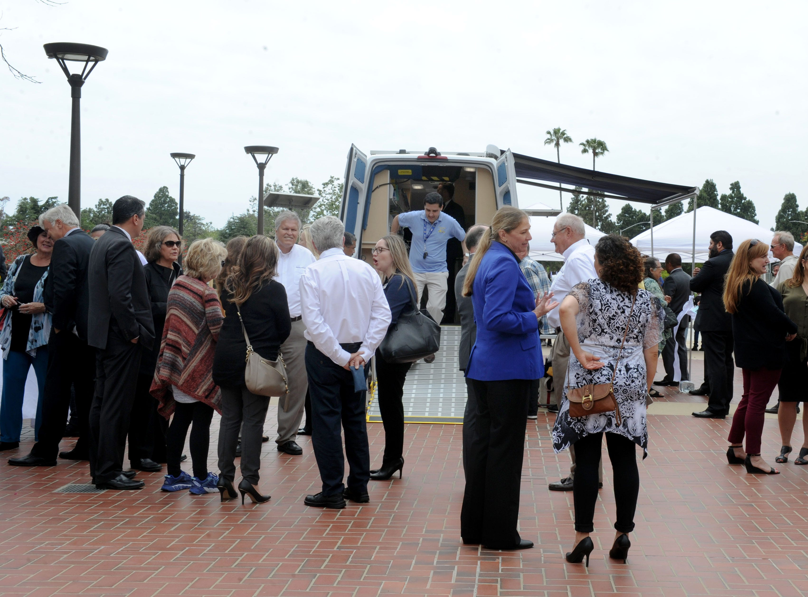 A large group of people gathers Tuesday to tour the Ventura County Library's new mobile library at the Ventura County Government Center.