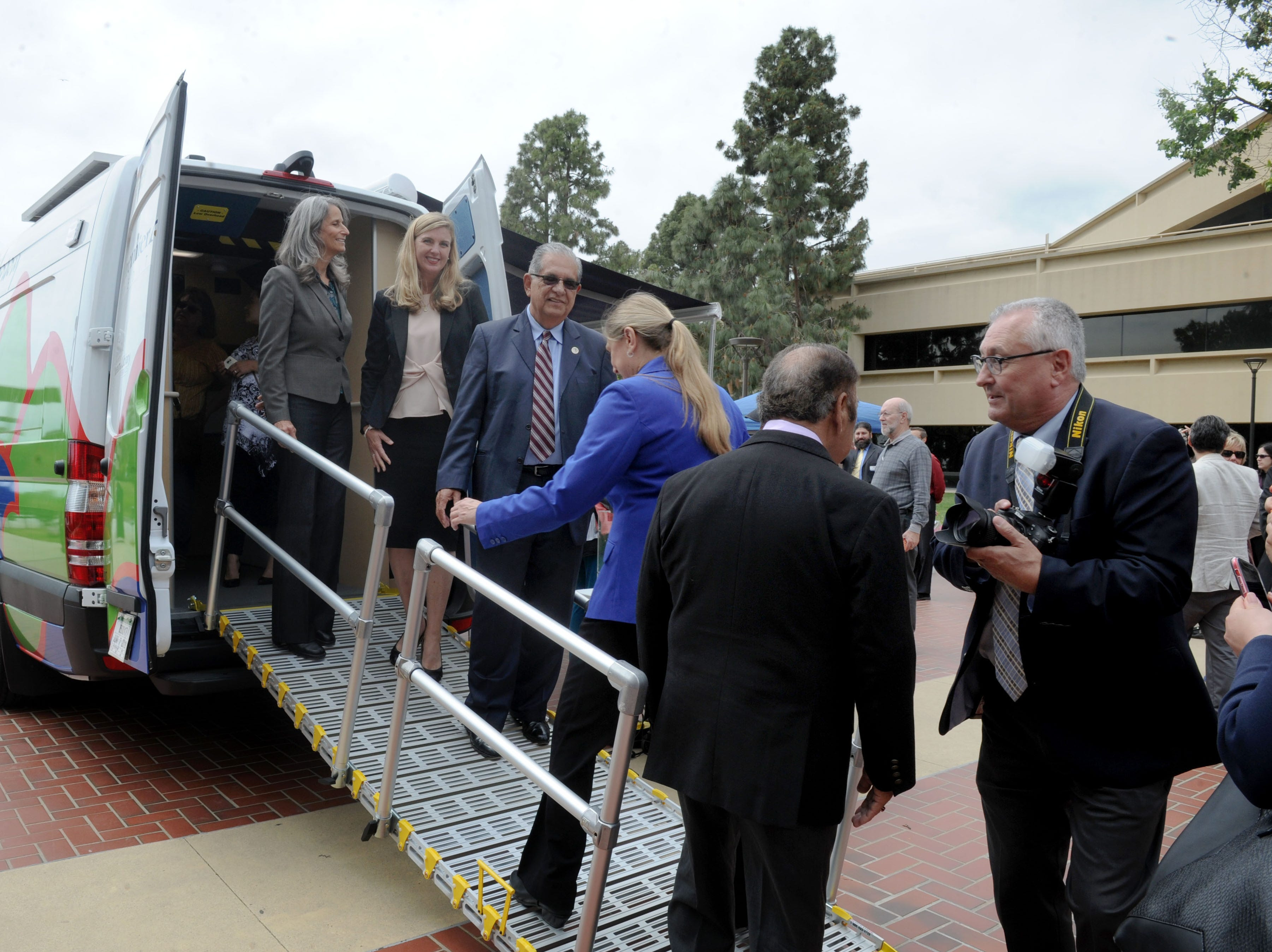 County supervisors and others tour the Ventura County library system's new mobile library at the Ventura County Government Center on Tuesday.  The nonprofit Ventura County Library Foundation, in partnership with the library system, invited the community to attend the launch and ribbon-cutting event Tuesday for the new mobile library.