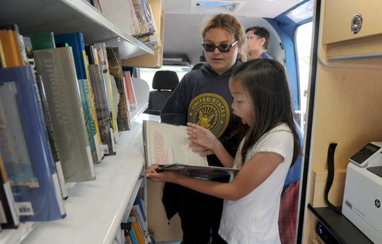 The Ventura County Library system's mobile library remained open Friday, but other libraries in Ventua County have closed due to the coronavirus pandemic.