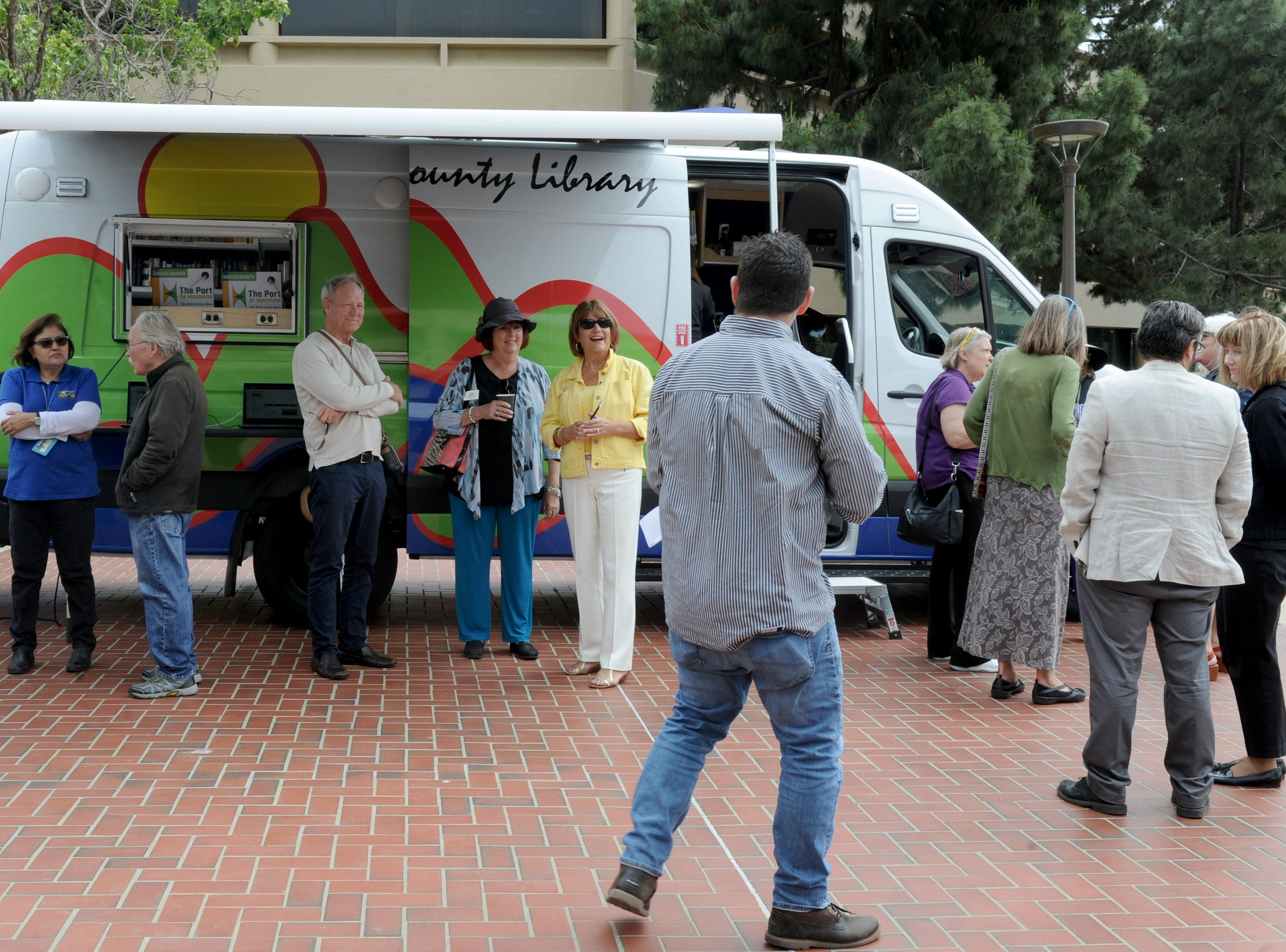 A large group of people line up Tuesday to tour the Ventura County Library's new mobile library, a 26-foot, fuel-efficient vehicle stocked with many of the same services found in a traditional library.