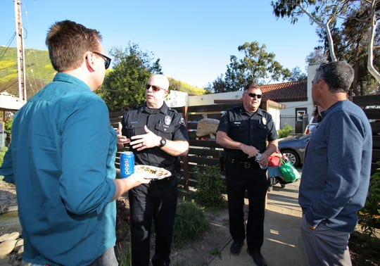"Ventura Police Department Assistant Chief Darin Schindler, left, and Police Chief Ken Corney talk with Westside Community Council  Chair/CEO James A. Forsythe and local businessman Ben Cabrera during the ""Tacos with a Cop"" fundraising event at the Restore Ventura Garden in Ventura on May 3. The fundraiser was held to support three local youth programs: Kids Garden Brigade, Creative Play and the Avenida Surf Club."