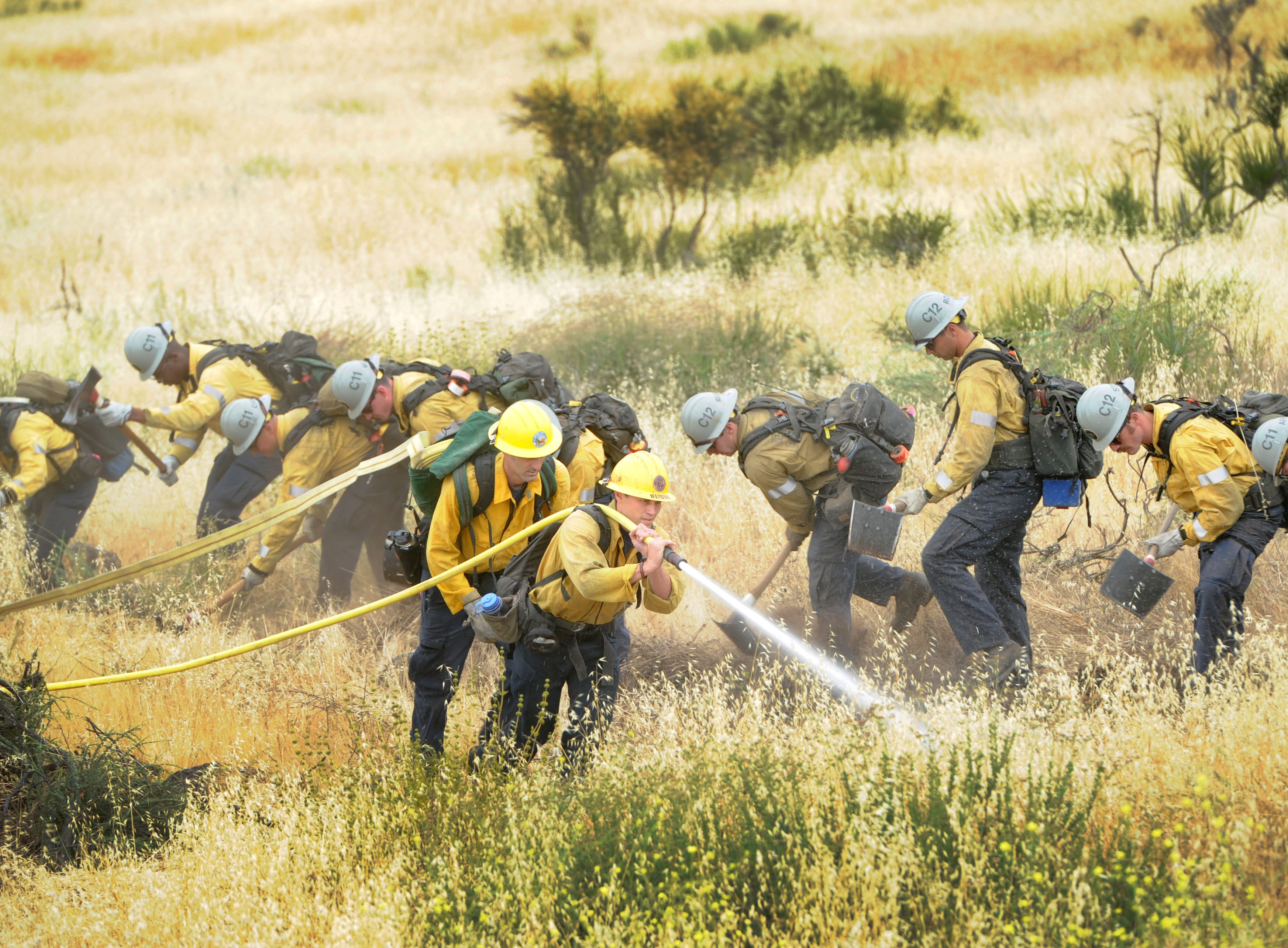"""Hand crews demonstrate how to cut a fire line Wednesday at the Southern California """"Ready for Wildfires"""" event Wednesday at the Reagan Library in Simi Valley."""