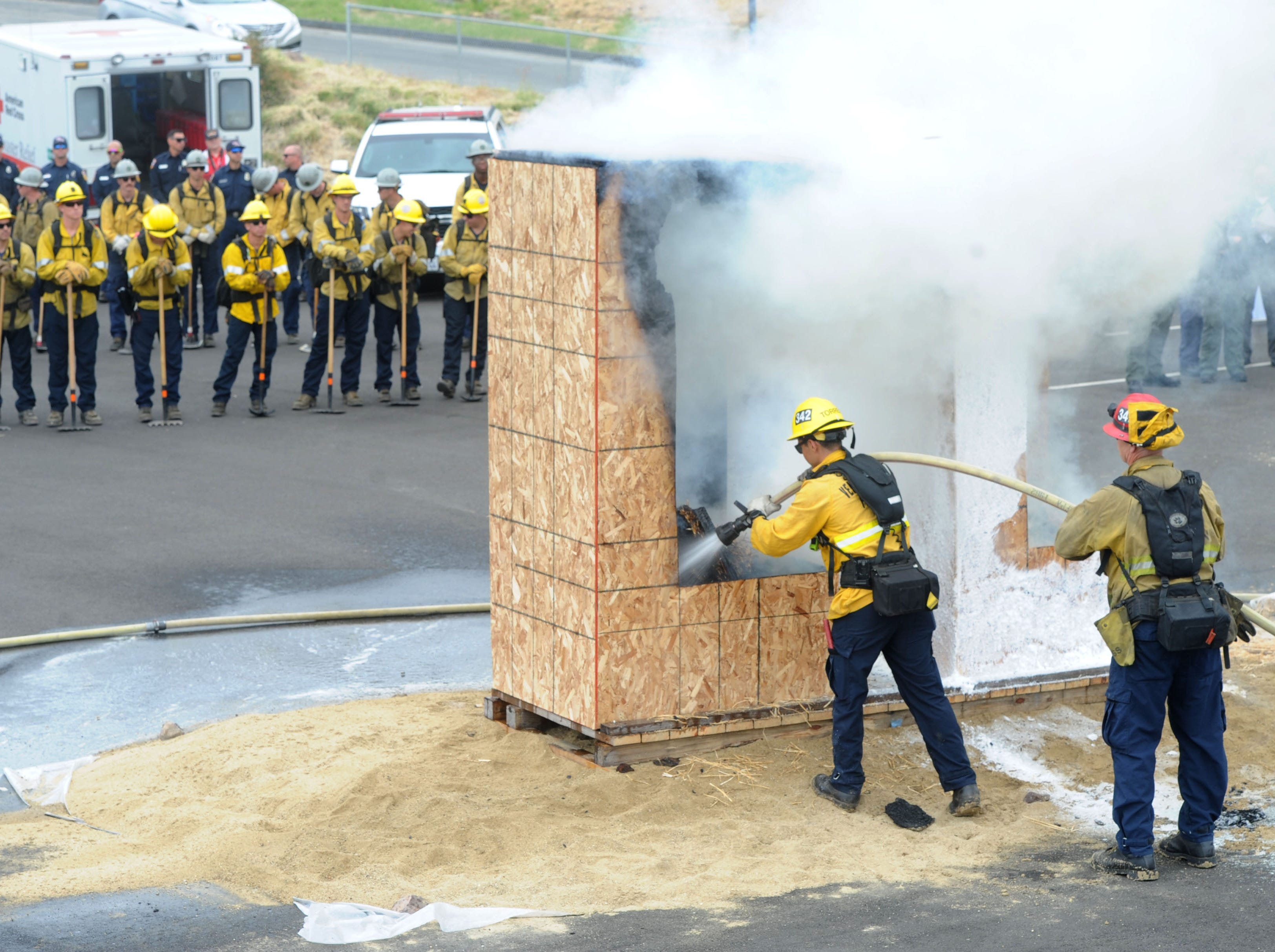 """Firefighters douse flames after a fire demonstration Wednesday at the Southern California """"Ready for Wildfires"""" event at the Reagan Library in Simi Valley."""