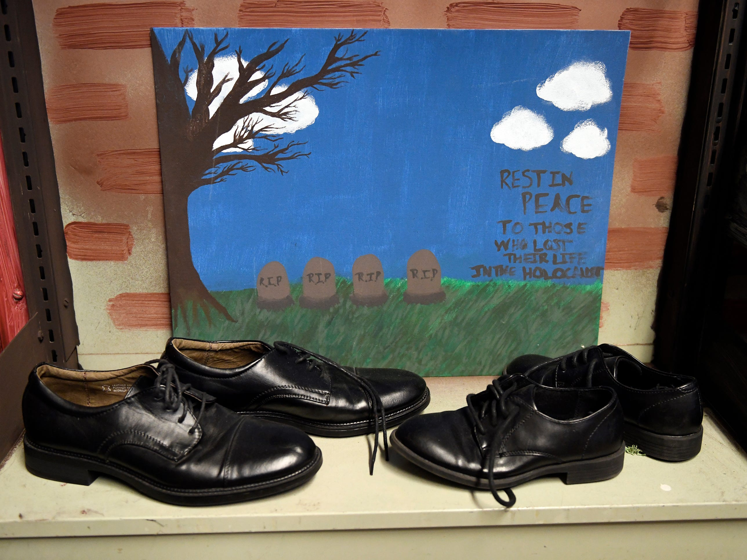 The permanent exhibit to honor Vineland Holocaust survivors replicates the Holocaust Museum display of shoes confiscated from concentration camp prisoners along side student artwork.