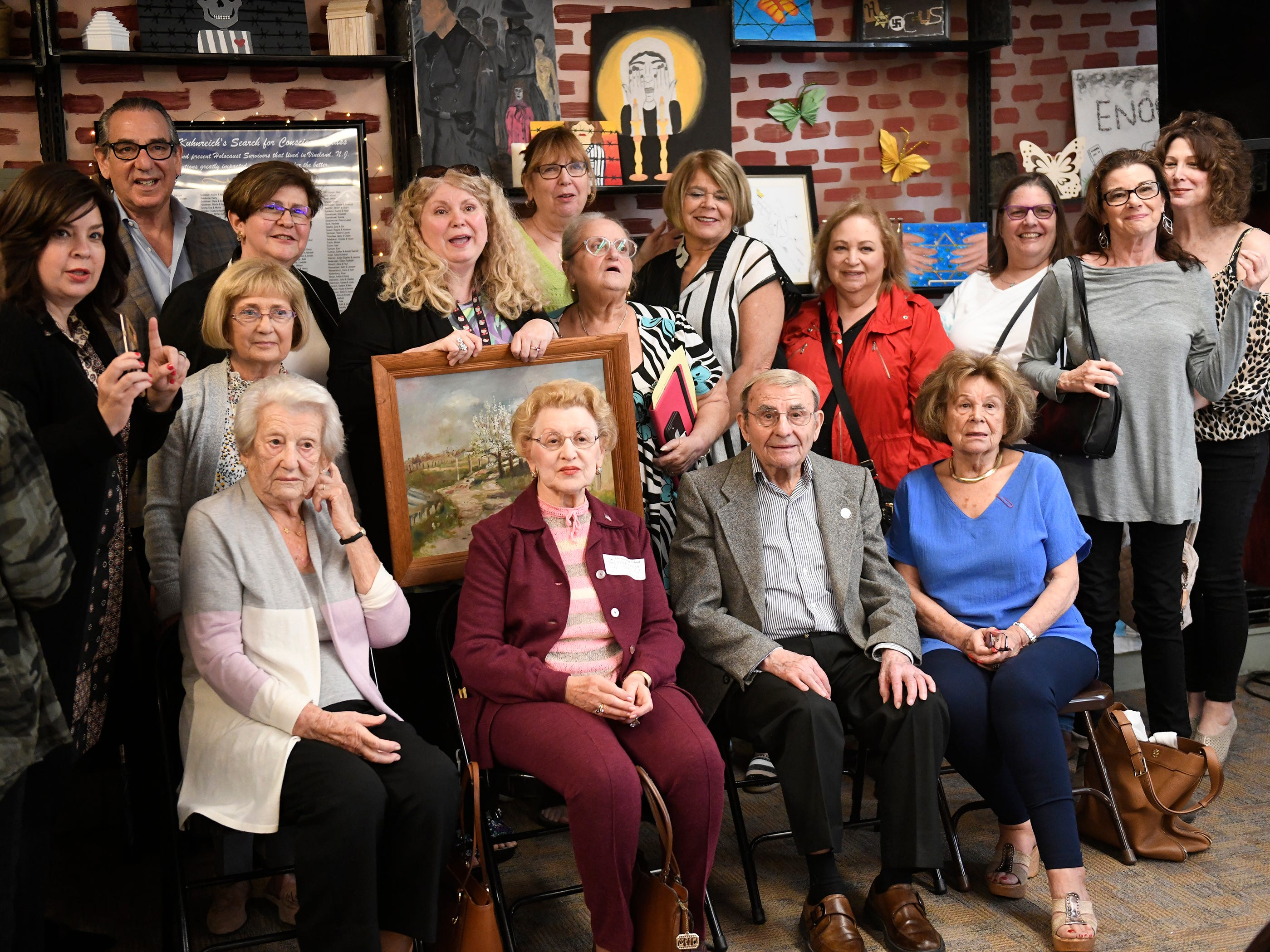 Holocaust survivors front row left to right, Elizabeth Roth, Genia Kuhnreich, Isadore Randel and Phyllis Dunkleman attend a dedication for the Kuhnreich/Teichman/Media Holocaust Research Center and Permanent Exhibit at Vineland High School.