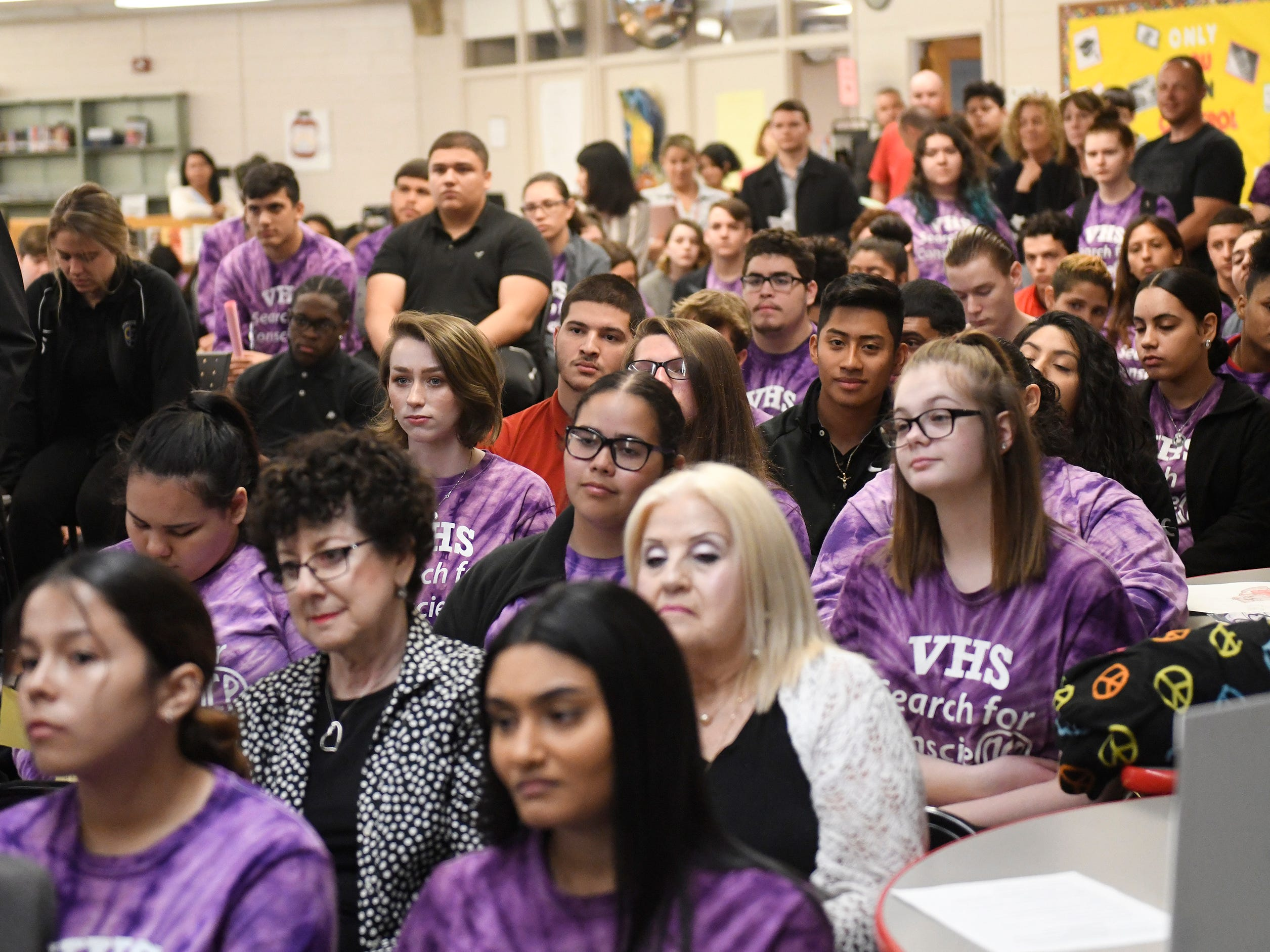 Vineland High School Search for Conscience students, purple shirts, attend the permanent exhibit dedication for Vineland Holocaust survivors in the school library on Wednesday, May 8, 2019.