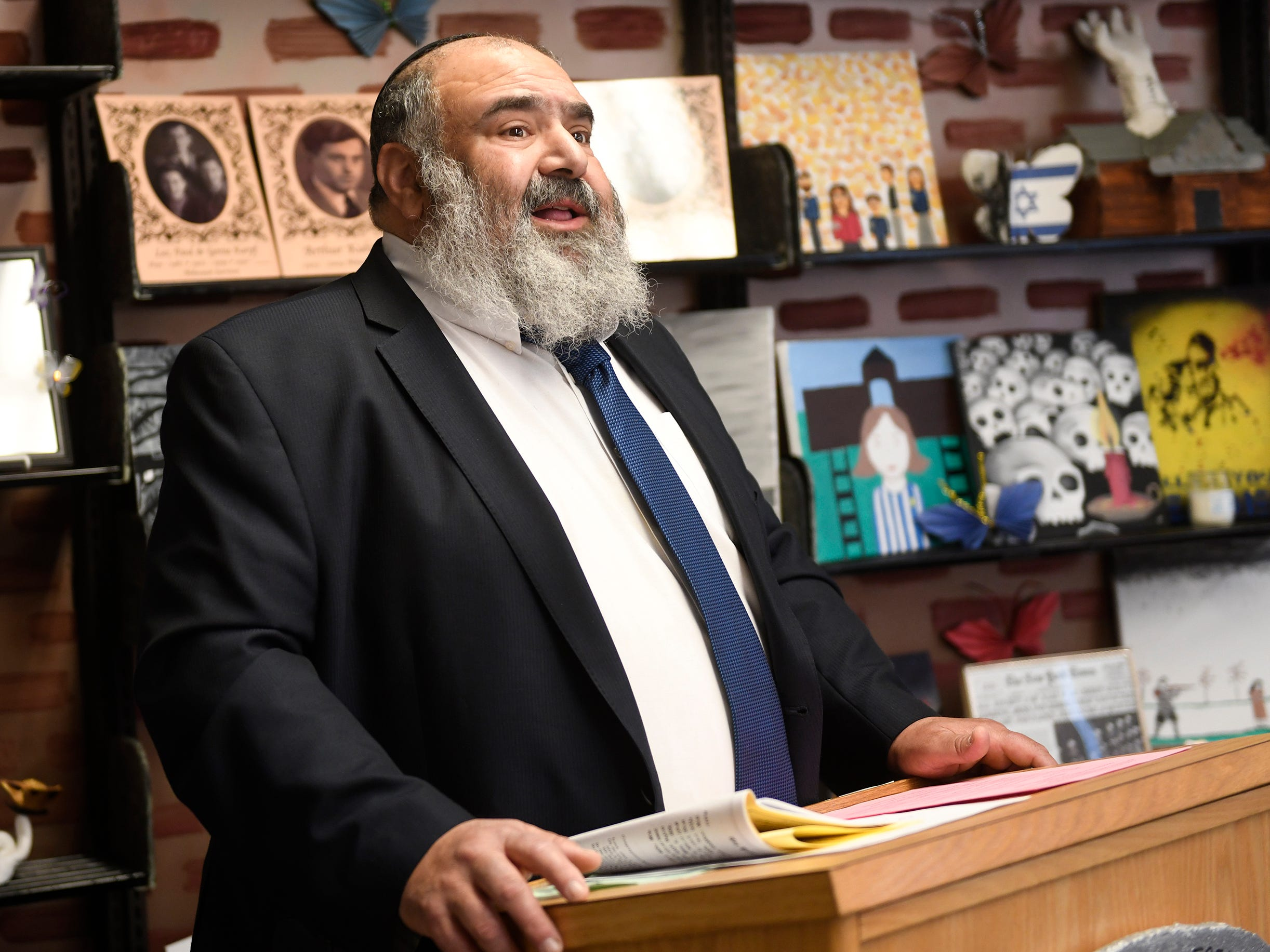 Rabbi Yisroel Rapoport speaks during a special dedication for a permanent Vineland Holocaust survivors exhibit in the Vineland High School library on Wednesday, May 8, 2019.