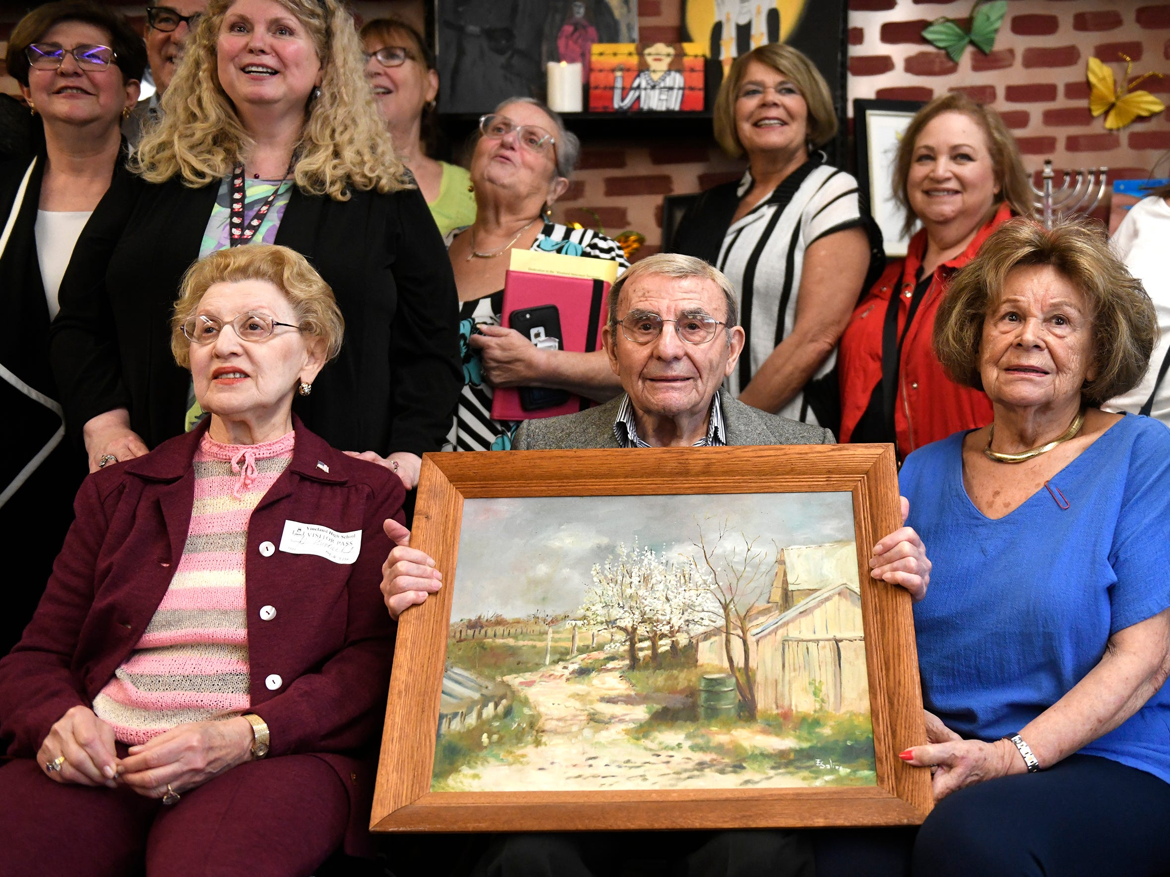 Holocaust survivors front row left to right, Genia Kuhnreich, Isadore Randel and Phyllis Dunkleman attend a dedication for the Kuhnreich/Teichman/Media Holocaust Research Center and Permanent Exhibit at Vineland High School.