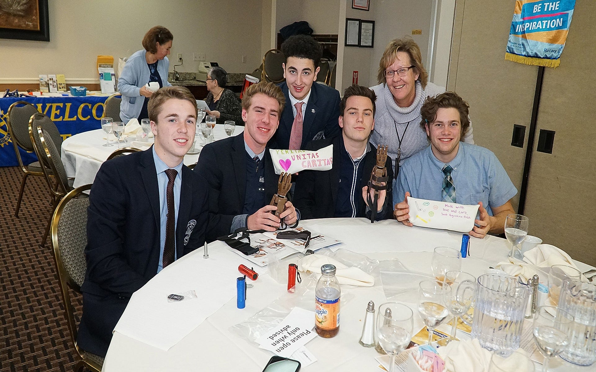 Members of St. Augustine College Preparatory School's Interact Club and their advisor, Nancy McHugh, assisted Rotary Club of Vineland with the assembly of prosthetic hands for distribution to people worldwide.