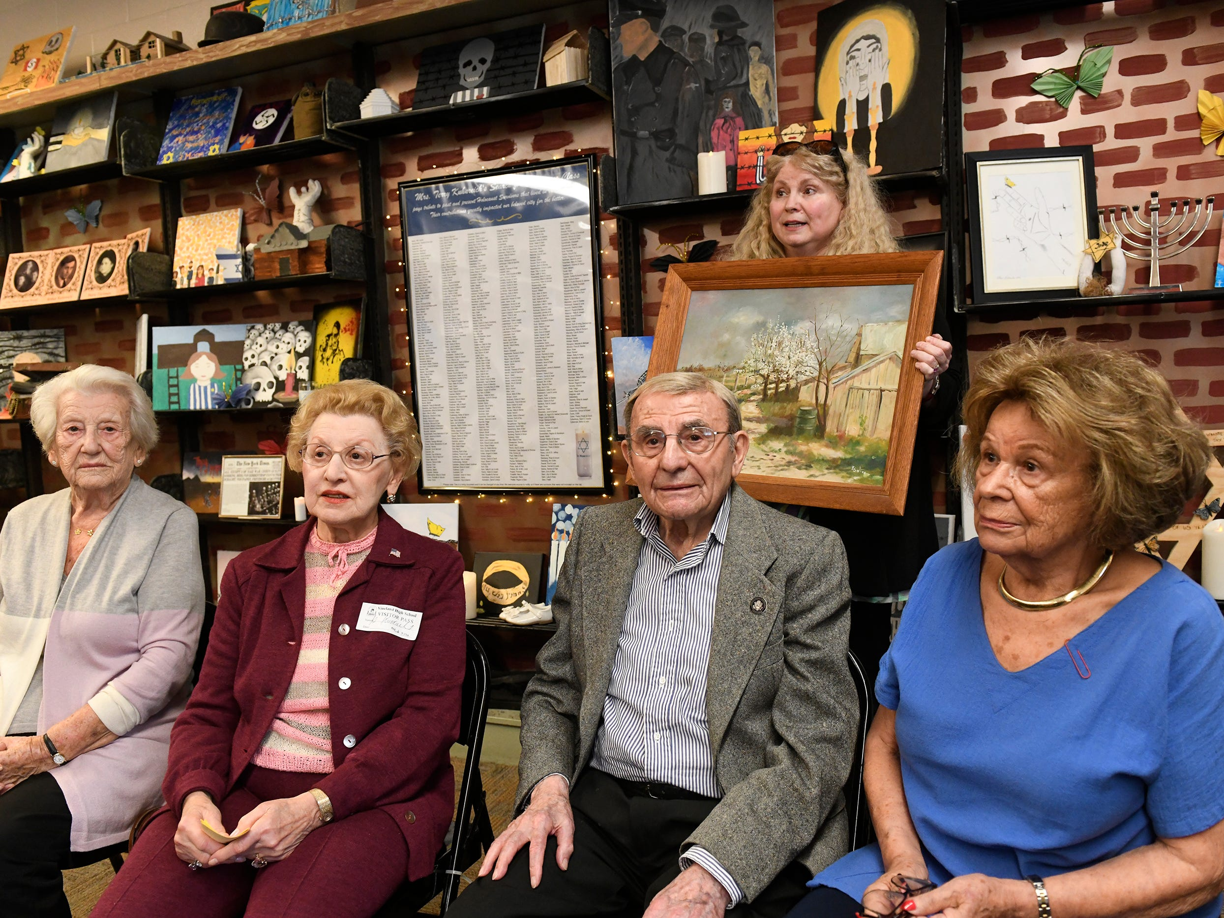 Holocaust survivors left to right, Elizabeth Roth, Genia Kuhnreich, Isadore Randel and Phyllis Dunkleman attend a dedication for the Kuhnreich/Teichman/Media Holocaust Research Center and Permanent Exhibit at Vineland High School.