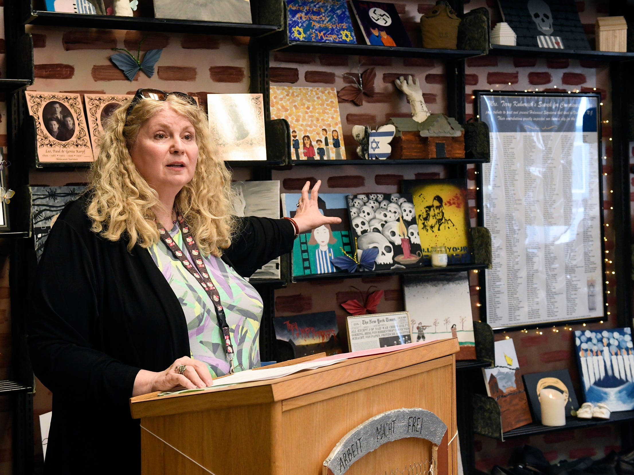 Mrs. Terry Kuhnreich, VHS Search for Conscience Teacher, speaks during a dedication at Vineland High School for a permanent exhibit to honor Vineland Holocaust survivors in the school library on Wednesday, May 8, 2019.