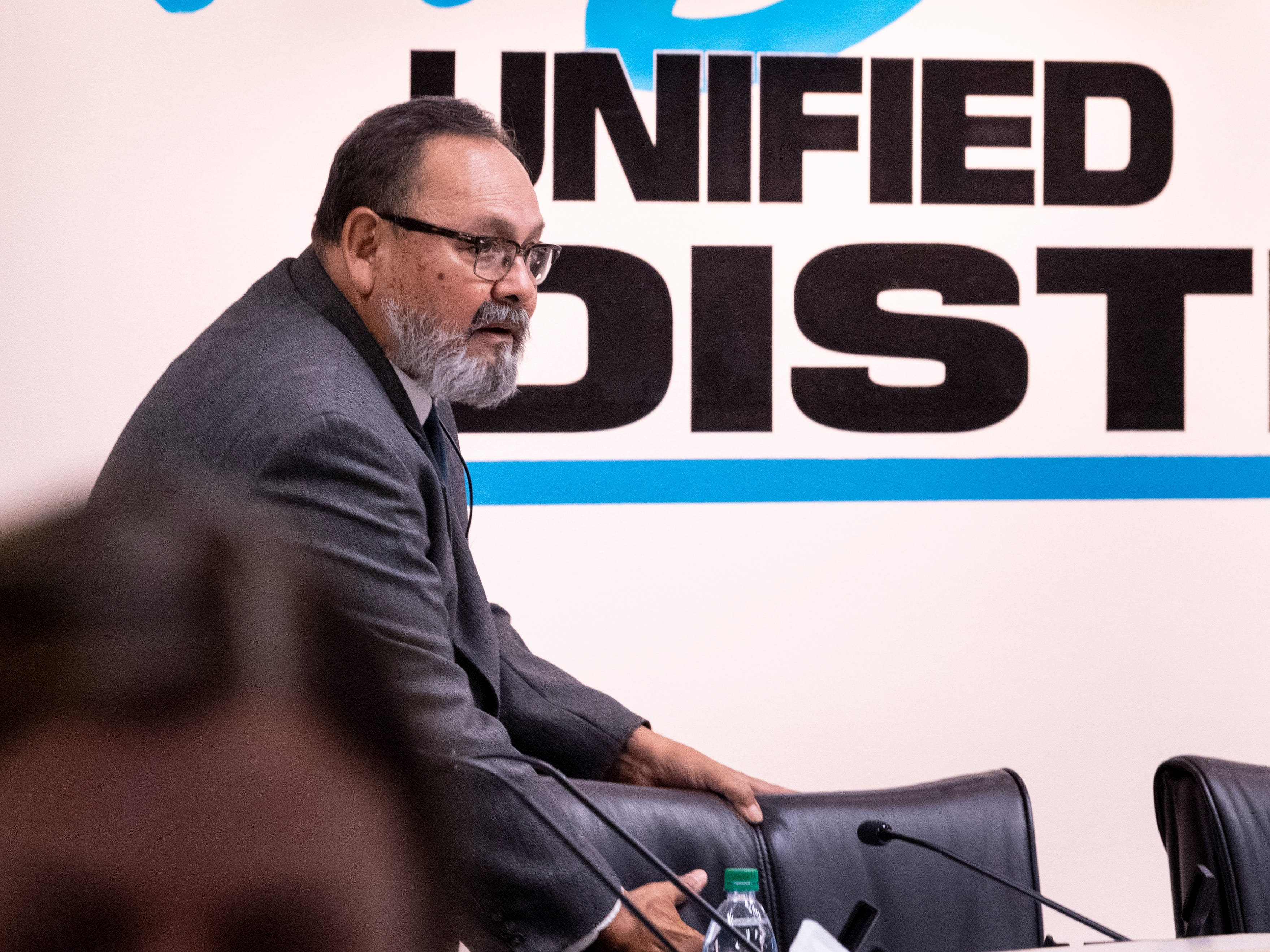 Visalia school board Trustee Juan Guerrero returns to his seat before the board announces they had voted to accept the resignation of Todd Oto on Tuesday, May 7, 2019.