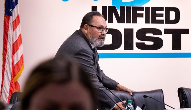 Visalia Unified board President Juan Guerrero returns to his seat during a May 7, 2019 meeting. Guerrero announced Tuesday that the public would be allowed to attend board meetings in the same room as board members at the end of this month.