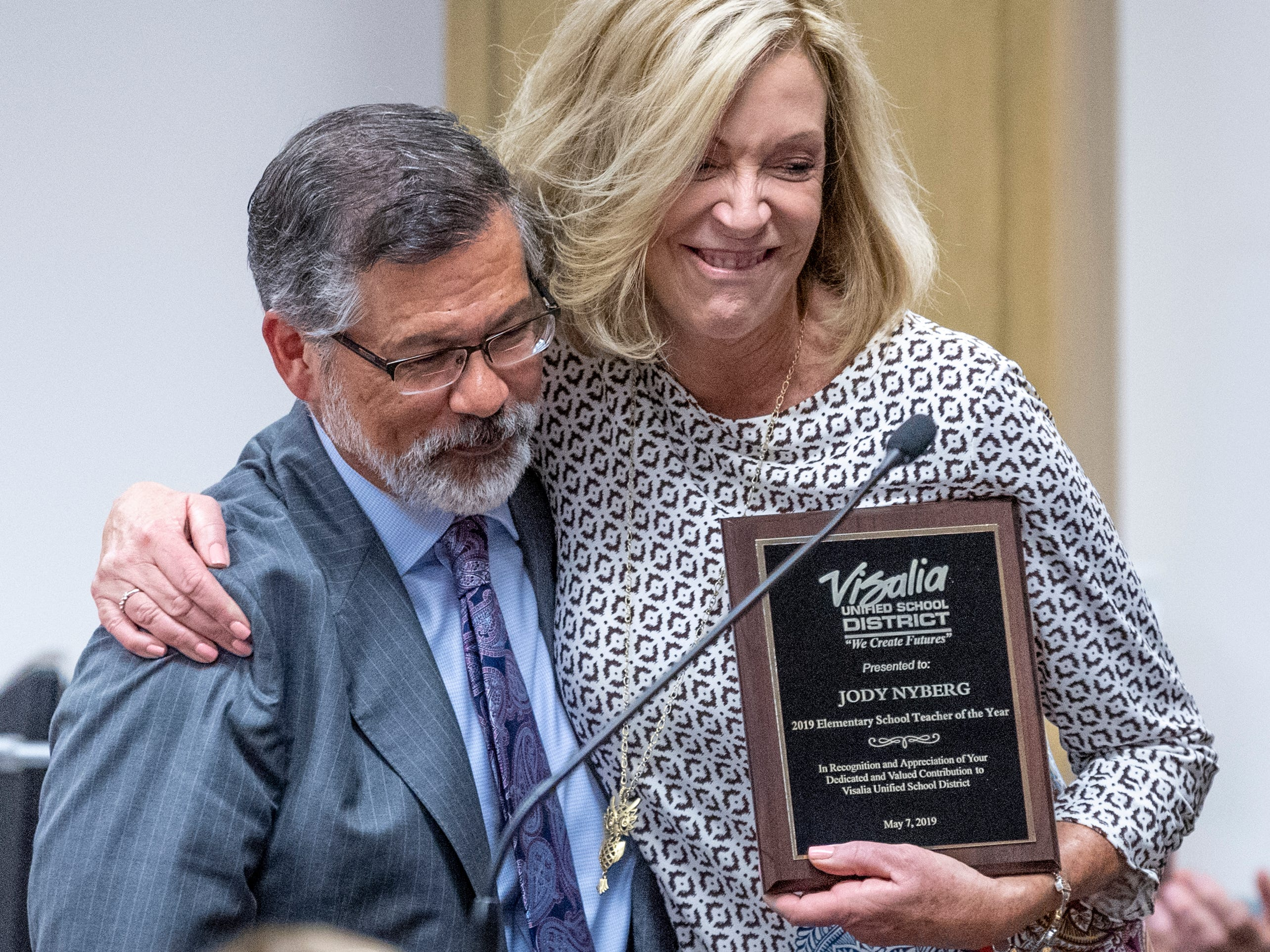 2019 Elementary School Teacher of the Year Jody Nyberg hugs Todd Oto after receiving her award on Tuesday, May 7, 2019.