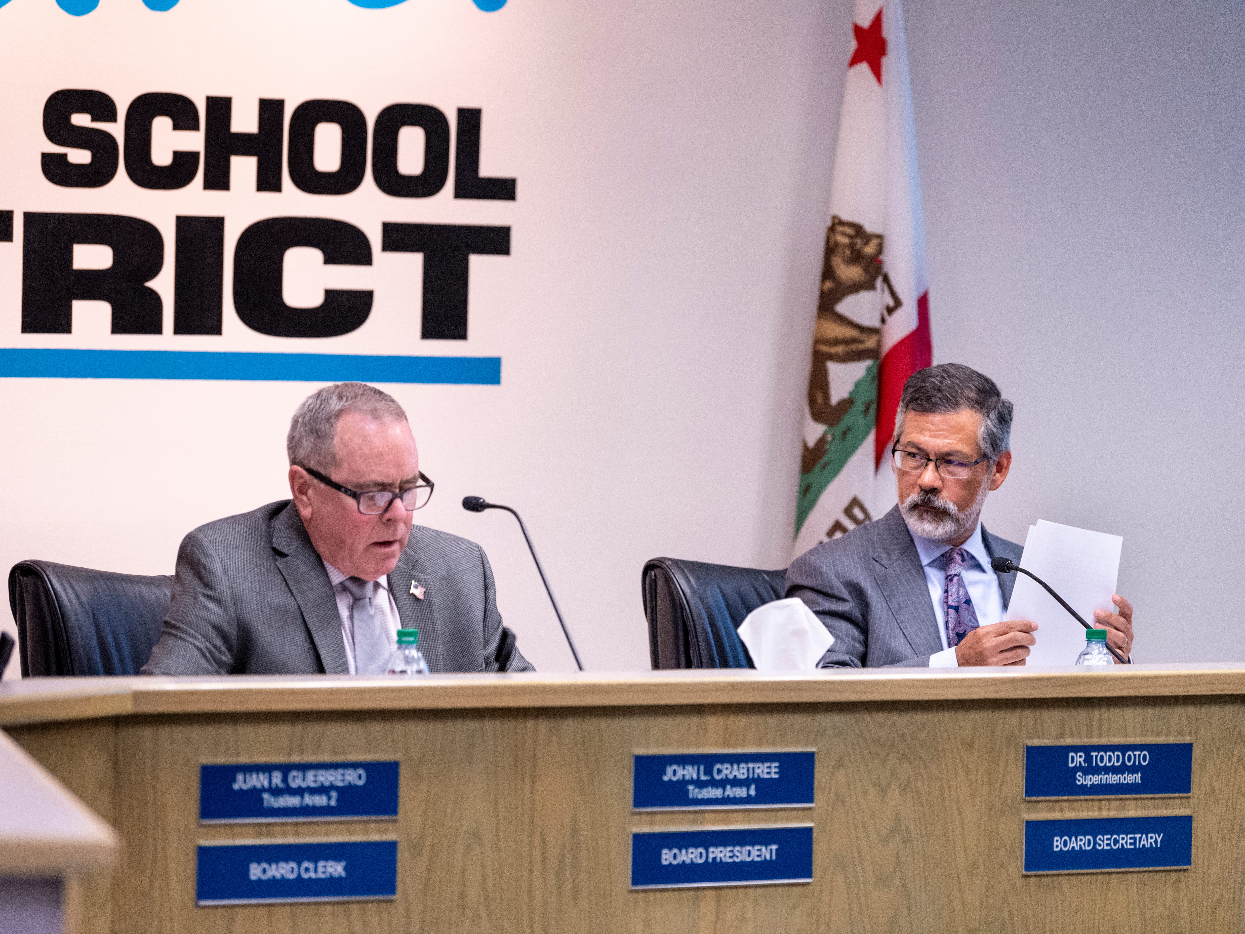 Visalia school board Trustee John Crabtree, left, announces the board had voted to accept the resignation of Superintendent Todd Oto on Tuesday, May 7, 2019.