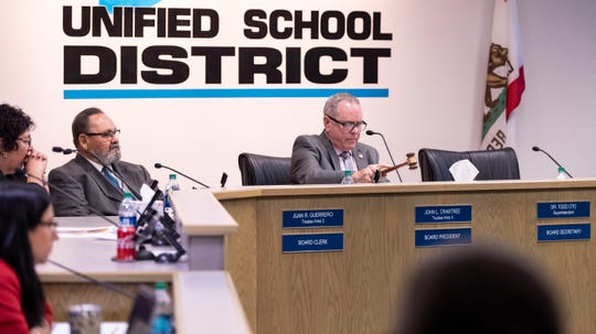 Visalia school board Trustee John Crabtree, right, calls the meeting to order before the board announces they had voted to accept the resignation of Superintendent Todd Oto on Tuesday, May 7, 2019.