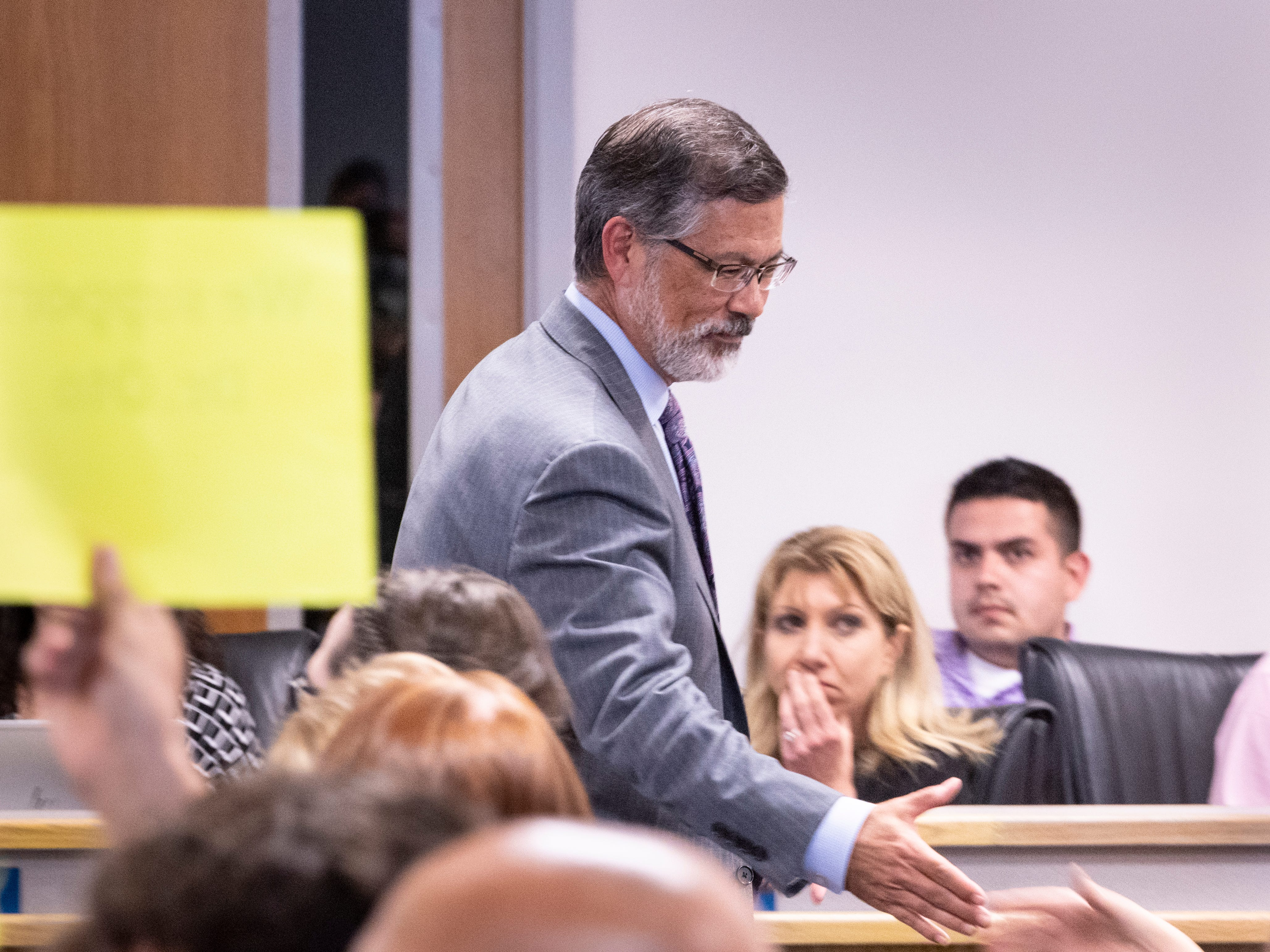 Superintendent Todd Oto shakes the hands of supporters during a special board meeting on Tuesday, May 7, 2019.